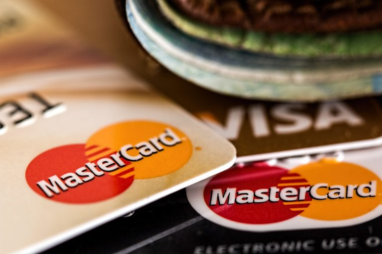 Mastercard and Visa credit cards stacked on top of one another